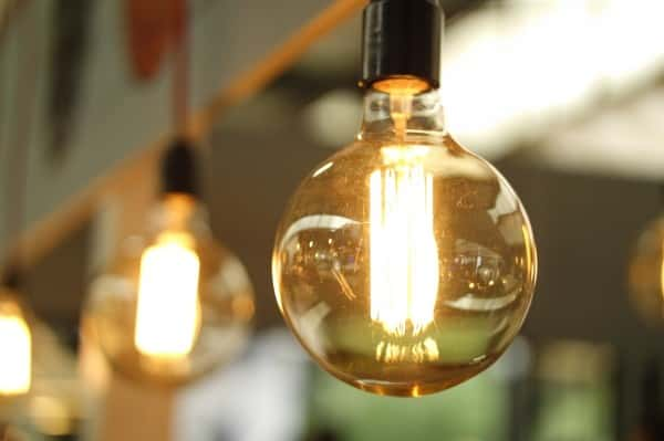 an image of an exposed lightbulb, which would be checked for its efficiency during assesments for energy performance certificates
