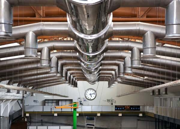 an image of a ventilation system in a large warehouse