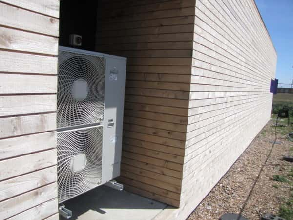 An image of a heat pump that has been installed on a property.