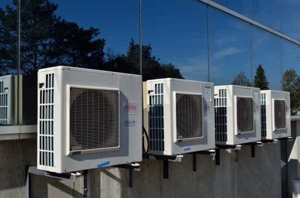 An image of air conditioning systems outside of a commercial building.